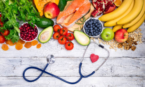 Healthy food for heart. Fresh fish, fruits, vegetables, berries and nuts. Healthy food, diet and healthy heart concept. Top view